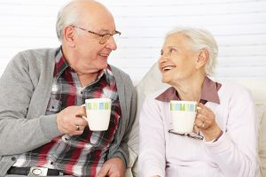 24908309 - happy senior citizen couple drinking coffee together