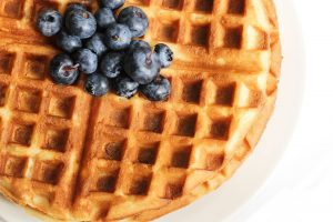 54724890 - warm waffle breakfast with blueberries made in a home kitchen