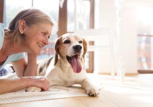 Senior woman enjoys pet friendly assisted living at Regency Morristown