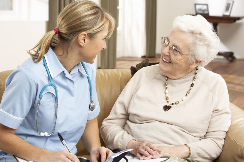 Senior woman discusses respite care with healthcare nurse.